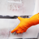 What causes defrost problem in a refrigerator?