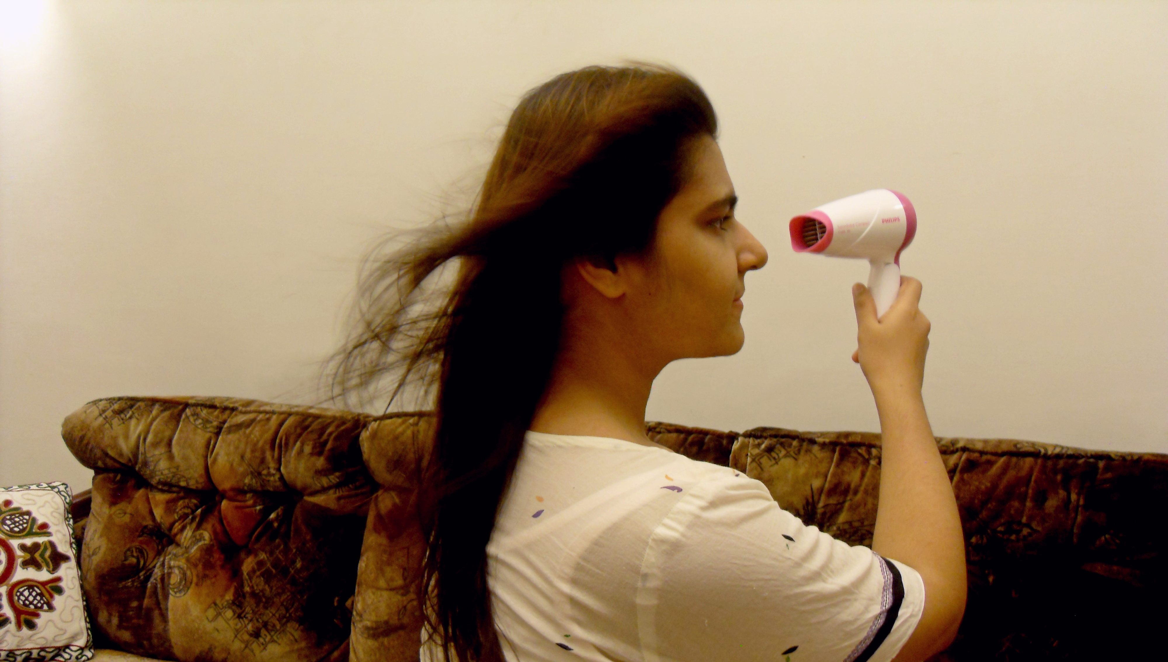 using a hair dryer from far away