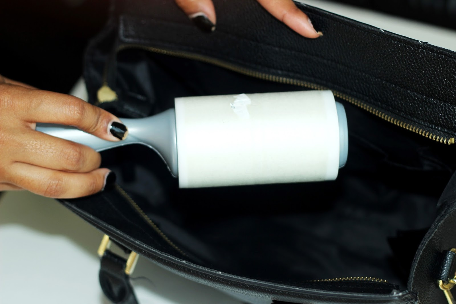 lint roller to clean art leather purse