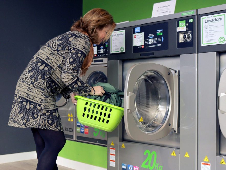 woman washing clothes in washer