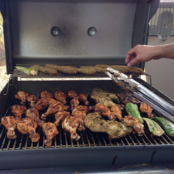 flipping meat on barbecue