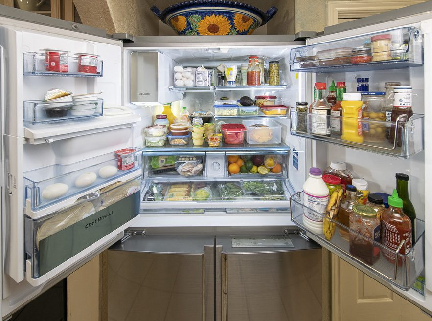 overstuffed and poorly organized refrigerator