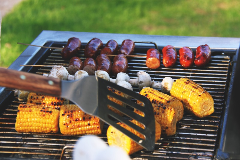 Charcoal barbecues grilling corn