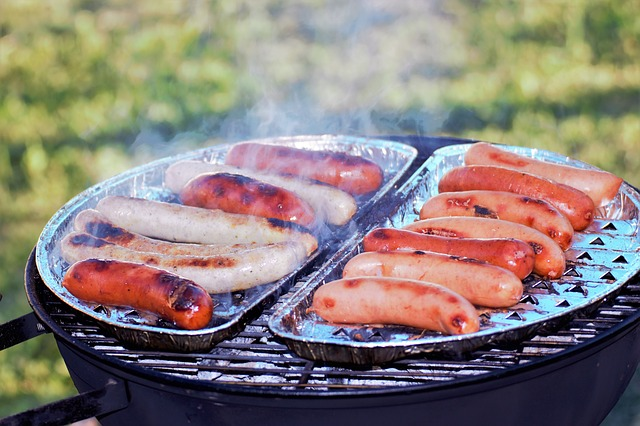 hot dogs on a portable grill