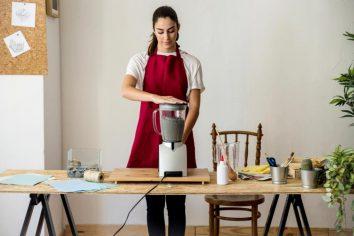 Women using a mixer grinder